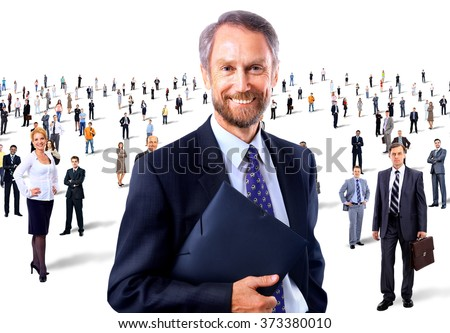 Portrait of a senior smiling man in front of a group of people - stock photo