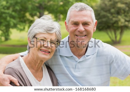 Portrait of a senior woman and man sitting at the park