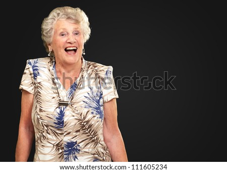Portrait Of A Senior Woman Happy On Black Background - stock photo