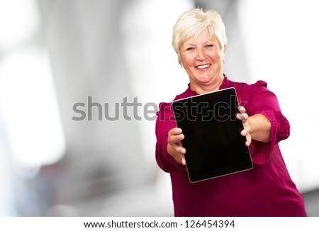 Portrait Of A Senior Woman Holding A Laptop, Background - stock photo