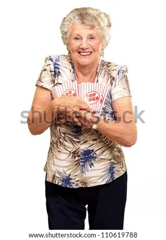 Portrait Of A Senior Woman Holding Popcorn Box On White Background - stock photo