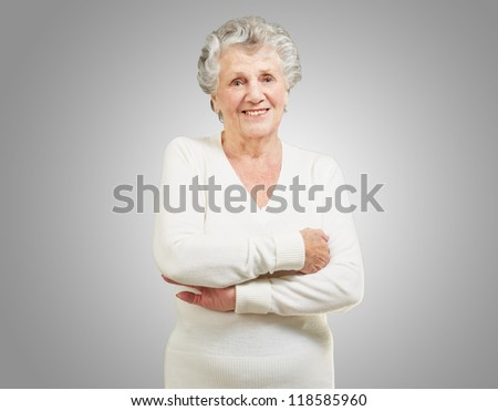 Portrait Of A Senior Woman On Gray Background - stock photo