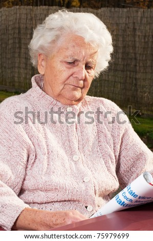 Portrait of a senior woman, picture taken during the daytime. - stock photo