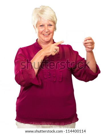 Portrait Of A Senior Woman Pointing To The Blank Card On White Background - stock photo
