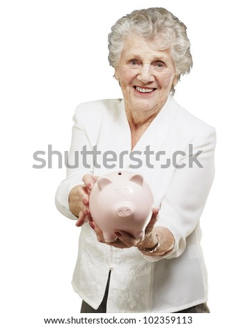 portrait of a senior woman showing a piggy bank over a white background
