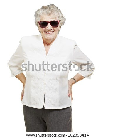 portrait of a senior woman standing and wearing sunglasses over a white background - stock photo