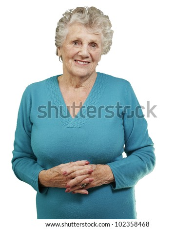 portrait of a senior woman standing over a white background - stock photo