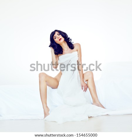 Portrait of a sensual sexy girl in white bed - stock photo