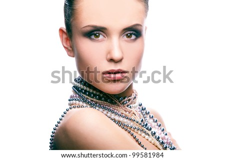 Portrait of a sensual woman wearing pearls - stock photo
