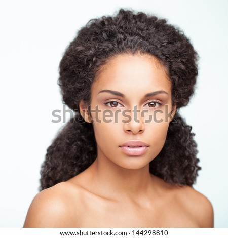 Portrait of a sensual young African woman posing againt a white background. - stock photo