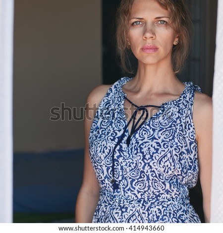 Portrait of a sensual young woman In a beautiful blue dress.  - stock photo