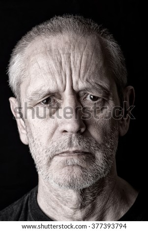 Portrait of a serious and angry man with a penetrating gaze and fury in the eyes - stock photo