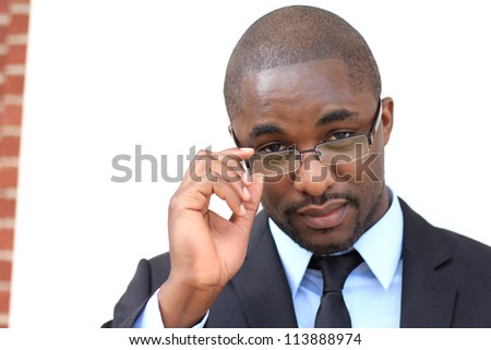 Portrait of a Serious and Attractive, Young Professional African American Businessman Wearing Glasses - stock photo