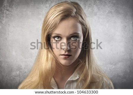Portrait of a serious beautiful young woman - stock photo