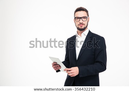 Portrait of a serious businessman holding tablet computer and looking at camera isolated on a white background - stock photo