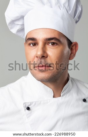 Portrait of a serious male chef.