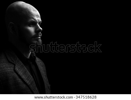 Portrait of a serious man in the darkness