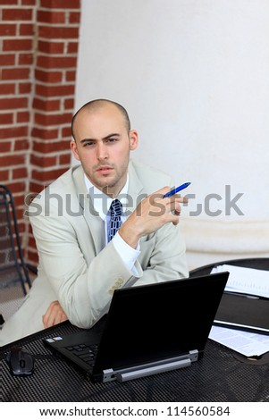Portrait of a Serious, Mature, and Attractive, Young Professional Businessman Working On Paperwork