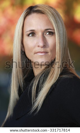Portrait Of A Serious Mature Woman Looking Away - stock photo