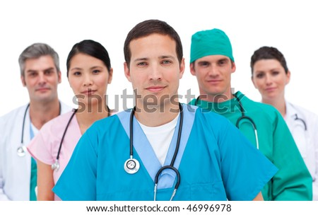Portrait of a serious medical team against a white background - stock photo