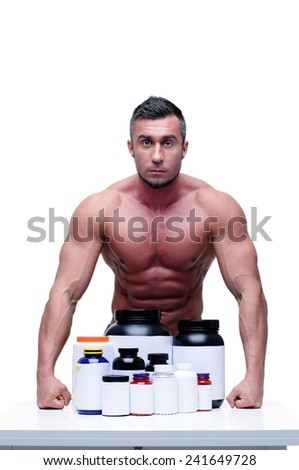 Portrait of a serious muscular man with sports nutrtion