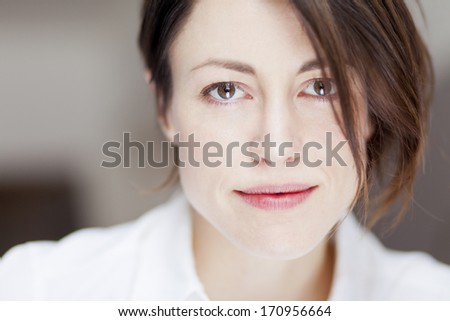 Portrait Of A Serious Woman Looking At The Camera. She is Sad And Maybe Depress - stock photo