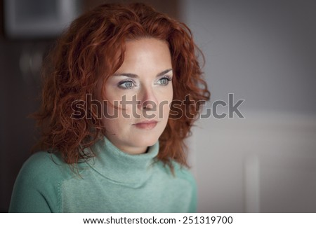 Portrait Of A Serious Woman lost in thought - stock photo