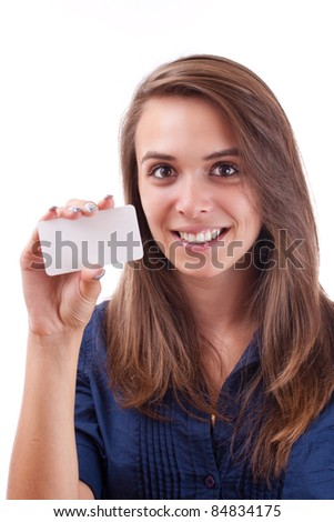 Portrait of a serious young woman holding a blank card in her hand against white background - stock photo