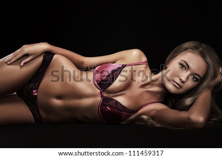 Portrait of a sexual woman in lingerie over black background.