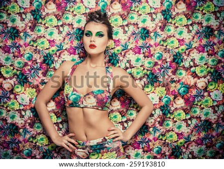 Portrait of a sexual woman in lingerie over bright floral background. Beauty, fashion. - stock photo