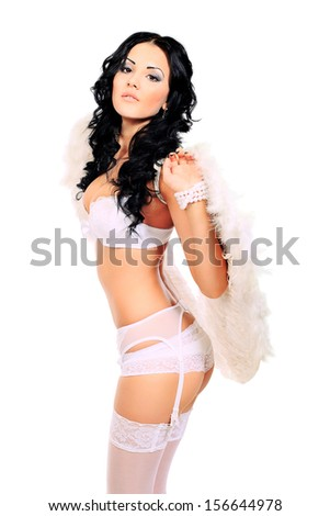 Portrait of a sexual young woman angel. Isolated over white background. - stock photo