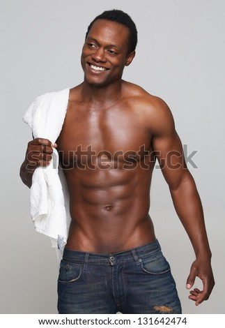 Portrait of a sexy african american man smiling - stock photo