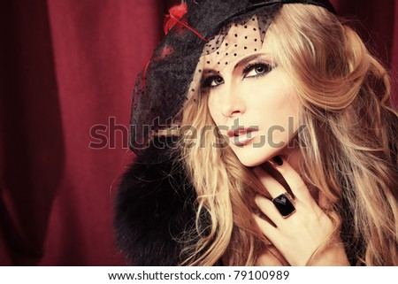 Portrait of a sexy beautiful woman over vintage background. - stock photo