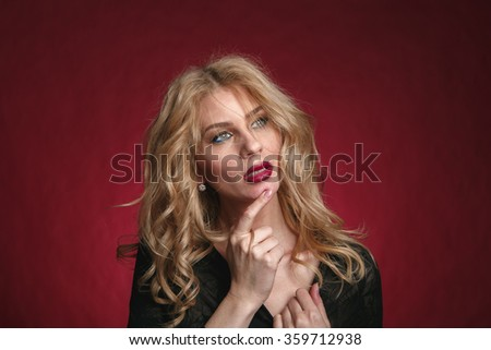 Portrait of a sexy blonde with red lipstick