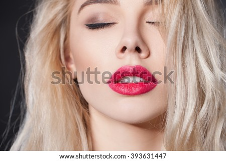 Portrait of a sexy blonde woman close-up, red lips big