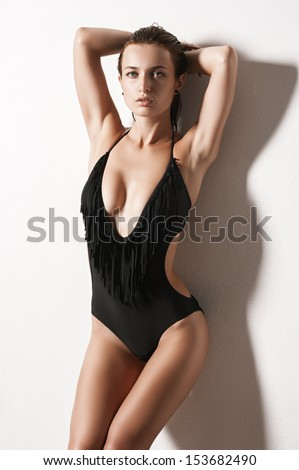 portrait of a sexy fashionable girl in a bathing suit  - stock photo