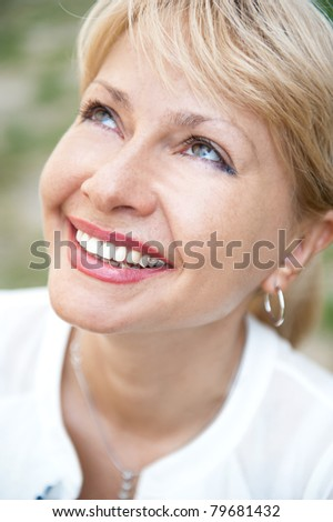 Portrait of a sexy  female smiling in a park - Outdoor