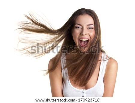 portrait of a sexy happy young woman with long flying hair on white background