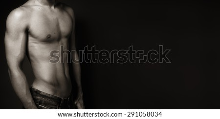 portrait of a sexy muscular shirtless man against neutral black and white - stock photo