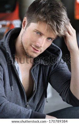 Portrait of a sexy playful young man - stock photo