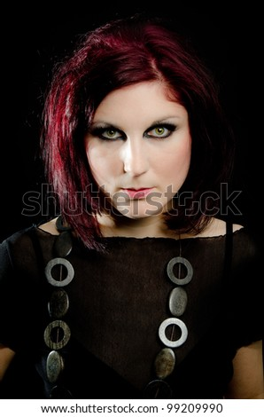 Portrait of a sexy, wild girl with intense green eyes - stock photo