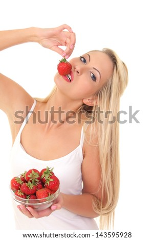 Portrait of a sexy young blond woman with strawberry