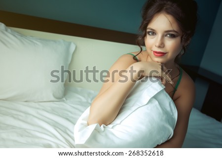 Portrait of a sexy young woman in lingerie on the bed - stock photo