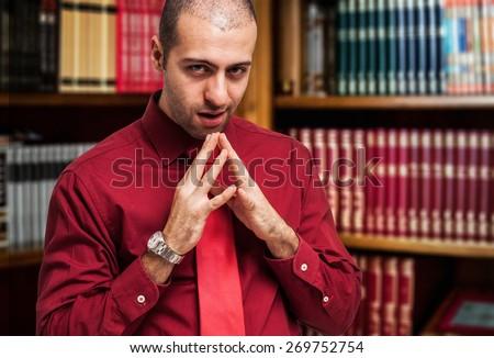 Portrait of a shady businessman - stock photo