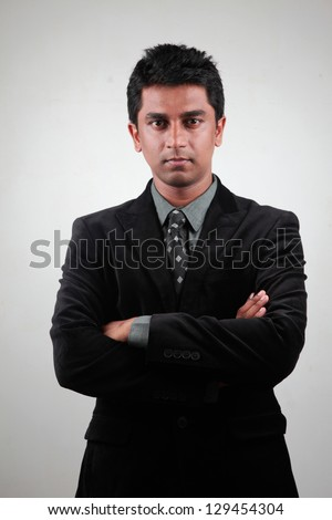 Portrait of a sharp looking young Indian businessman - stock photo