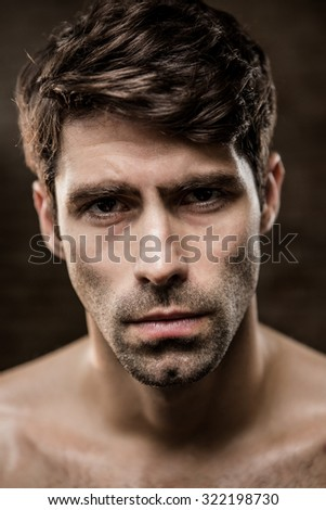 Portrait of a shirtless man at the gym - stock photo