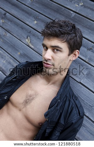 Portrait of a shirtless young man