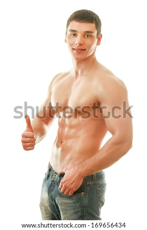 Portrait of a shirtless young man showing ok