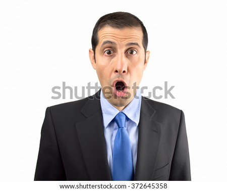 Portrait of a shocked businessman isoalted on white background - stock photo