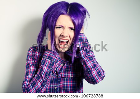 Portrait of a shouting punk girl with purple hair.